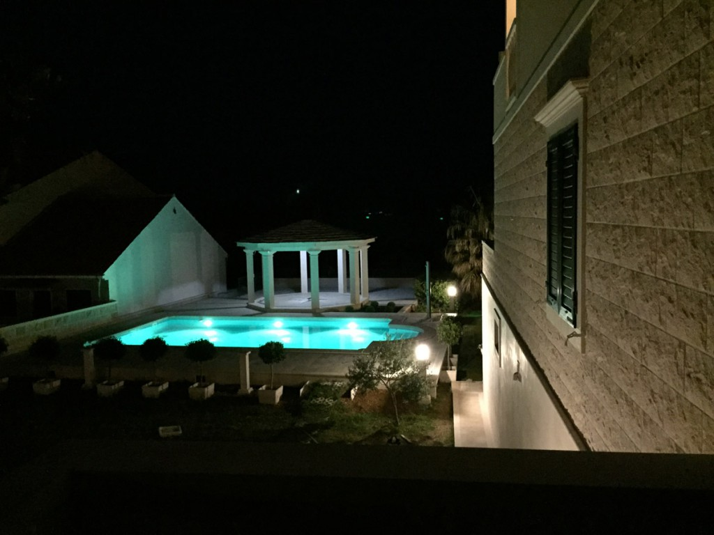 Swimming pool during the night. Swimming pool view.