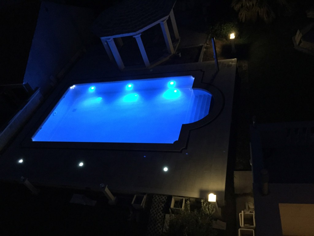The view on the swimming pool at night. Apartments Villa Jadranka
