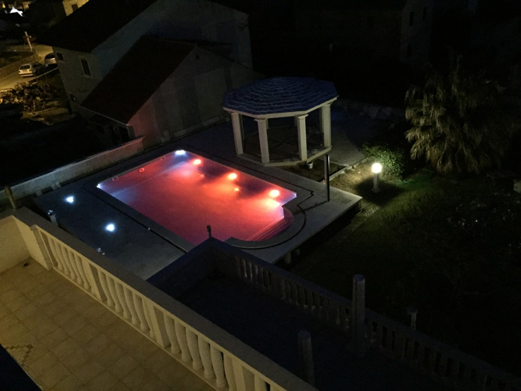 The view on the swimming pool at night. apartment Villa Jadranka